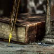 Stock Photo: Vintage lamp for the candle and old books on wooden table