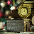 Old books and vintage clock on Christmas background. New year card in retro style. — Stock Photo #41144563