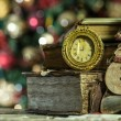 Old books and vintage clock on Christmas background. New year card in retro style. — Stock Photo #41144599