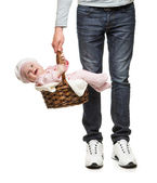 A man carrying a basket with a cheerful baby — Stock Photo