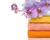 Colorful towels and flower isolated on white — Stock Photo