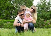 Portrait Of Happy Family In Garden — Stock Photo