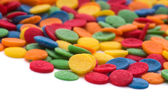 Colorful candy confetti on the white background — Stock Photo