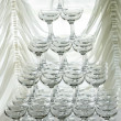 Pyramid holiday of champagne glasses on table in party — Stock Photo #47757025