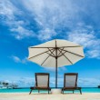 Beach lounger and umbrella on sand beach. Concept for rest, relaxation, holidays, spa, resort. — Stock Photo #49082355