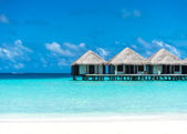 Beautiful beach with water bungalows at Maldives — Stock Photo