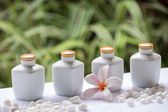 Spa and wellness setting with natural soap, stones and towel on the green background . Concept spa. — Stock Photo
