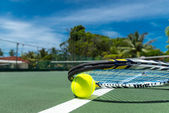 Close up view of tennis racket and balls on the clay tennis court — Stock Photo