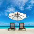 Beach lounger and umbrella on sand beach. Concept for rest, relaxation, holidays, spa, resort. — Stock Photo #50231407