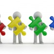 3d small people - colorful puzzle pieces — Stock Photo #41500521