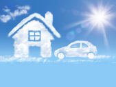 Cloud house and car in the blue sky and shining sun — Stock Photo
