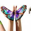 Child hands painted in colorful paints or tattoo with frog, butterfly, elephant. — Stock Photo