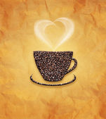 Coffee cup, beans on paper texture — Stock Photo