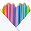 Heart of coloured pencils with set of paper — Stock Photo #26630081