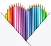 Heart of coloured pencils with set of paper — Stock Photo