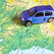 Car on a map — Stock Photo