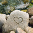 Wet heart on stone — Stock Photo