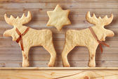 Gingerbread cookies on wooden background — Stock Photo