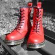 Red laced boots, on black-white background in park — Stock Photo