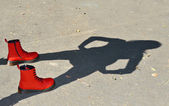 Red shoes and child shadow — Stock Photo