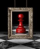 Chess pawn on golden frame — Stock Photo