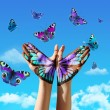 Hand and butterflys — Stock Photo
