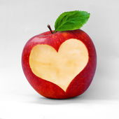 Red apple with a heart shaped cut-out. — Stock Photo