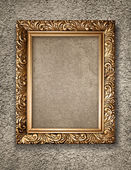 Antique golden frame on rustical wall — Stock Photo