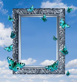 Butterflies in frame on blue sky. — Stok fotoğraf