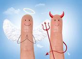 Angel and devil - happyfinger — Stock Photo