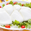 Mozzarella on a green salad — Stock Photo