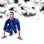 Start up man below black clouds — Stock Photo