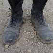 Dusty boots — Stock Photo