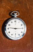 Pocket watch on leather background — Stock Photo