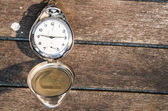 Pocket watch on distressed wood — Stock Photo