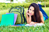 Woman Reading a Book On Grass — Stock Photo