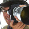 Close-up of White male photographer with 70-200mm lens — Stock Photo