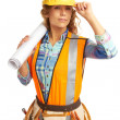 Stock Photo: Content beautiful female construction worker