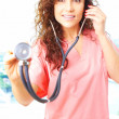 Stock Photo: Close-up of friendly beautiful nurse holding stetescope