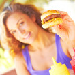 Woman Holding Mini Hamburger — Stock Photo
