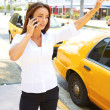 Stock Photo: Businesswoman hailing a yellow taxi cab
