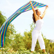 Carefree Female Holding Colorful Cloth — Stock Photo