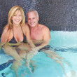 Stock Photo: Mature caucasion male and female relaxing in the pool