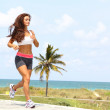 Healthy young woman jogging on a walkway — Stock Photo
