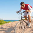 Stock Photo: Hispanic male with mountain bike riding downhill