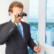 Male Executive Looking Through Binoculars — Stock Photo