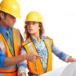 Attractive male and female construction workers looking at blue — Stock Photo