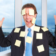 Furious Male Executive Covered With Adhesive Notes — Stock Photo