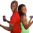 Happy male and female exercising with weights — Stock Photo