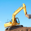Yellow Excavation Machine On Heap Of Soil — Stock Photo #29919735